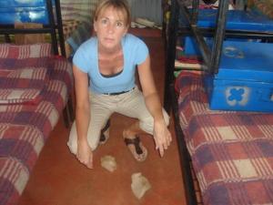 Mathare Valley Brenda inspects fem hygiene articles
