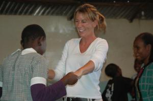 Mathare Valley slum school, Brenda being shown how to dance